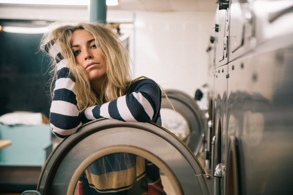 woman wasting an entire year doing laundry
